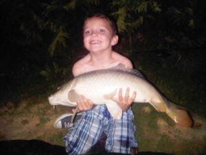 common-carp-caught-by-eight-year-old-boy-from-smallwater-lake-france